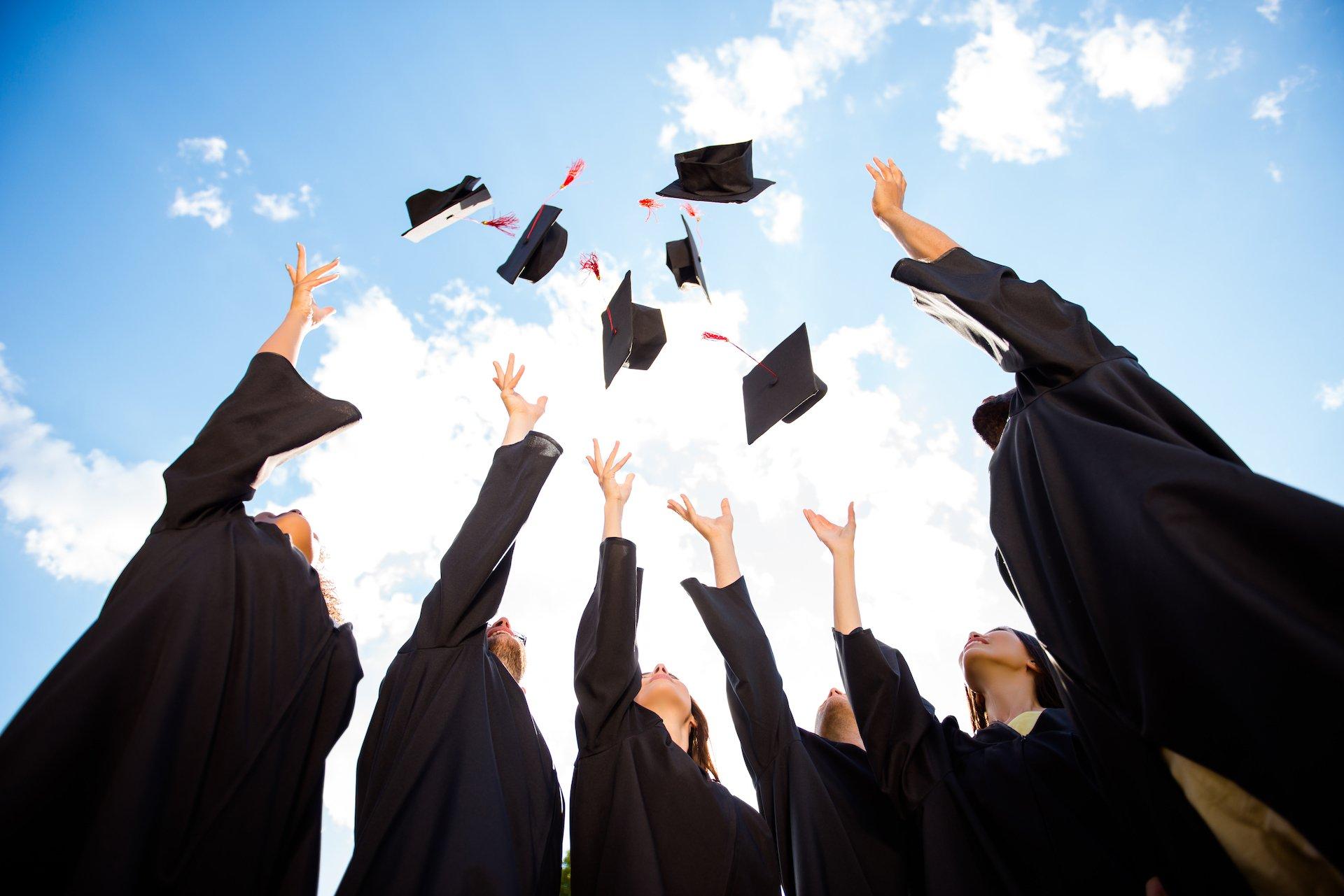 Academic graduates celebrating